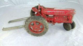 Vintage Red Hubley International Farm Tractor Toy w Long Spring Seat